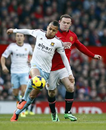 Ravel Morrison shields the ball from Wayne Rooney. Picture: Action Images