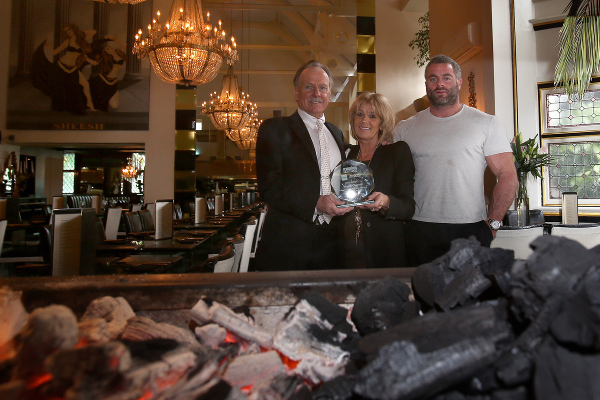Colin, Christine and Dylan Hunt with thier award at their family business Sheesh restaurant