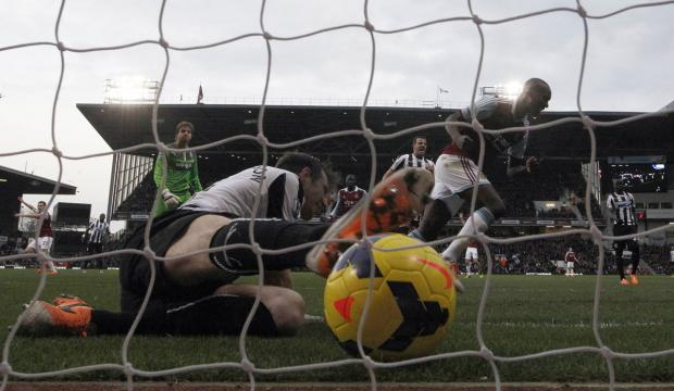Newcastle defender Mike Williamson is unable to prevent the ball from crossing the line. Picture: Action Images