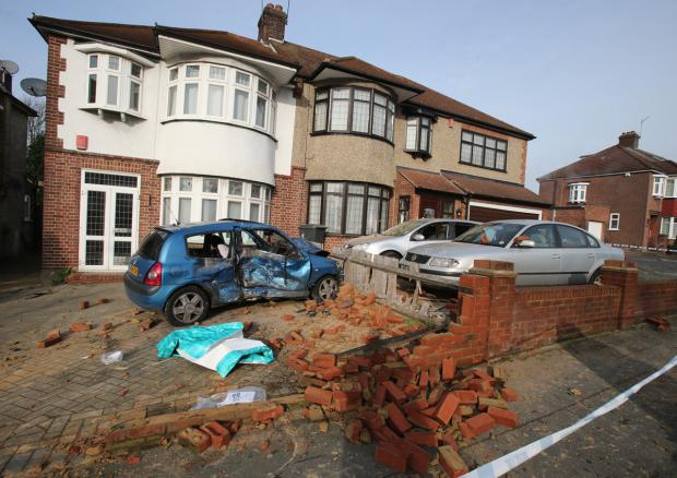 East London and West Essex Guardian Series: The blue Clio smashed through a front wall, throwing bricks through windows