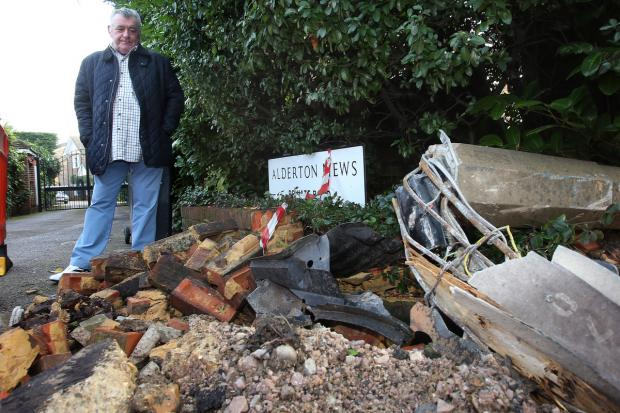 John Cassidy with the damage at Alderton Mews