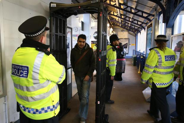 East London and West Essex Guardian Series: Officers and PCSO's use a knife arch to screen train users
