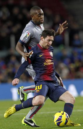 Raoul Loe challenges Barcelona's Lionel Messi. Picture: Action Images