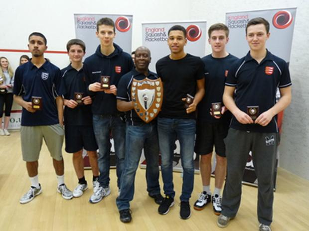 The triumphant Essex Under-19 squad with coach Dave Webster (centre).
