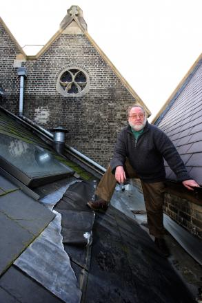 Chris Walker and the roof damage at Wanstead United Reformed Church