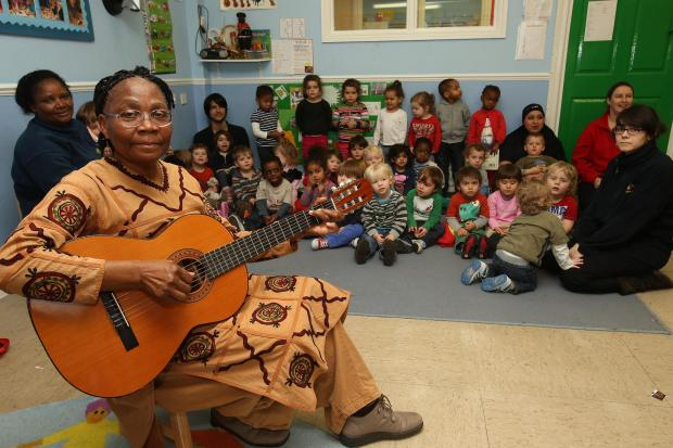 Storyteller Jane Grell with the children of Whipps Cross Busy Bees Nursery.