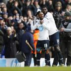East London and West Essex Guardian Series: Adebayor and Defoe celebrate after the final whistle