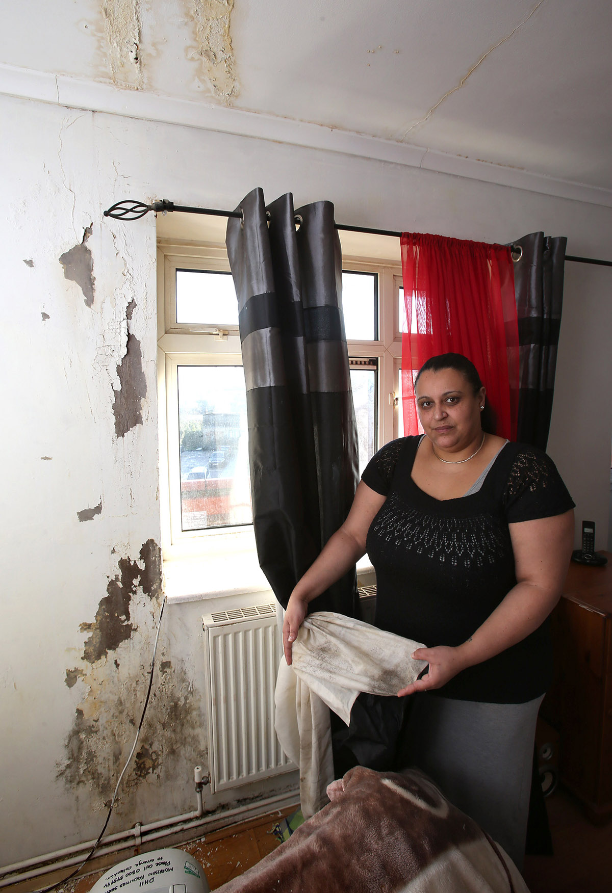 Amina Abou-El-Fotouh in her water damaged home.