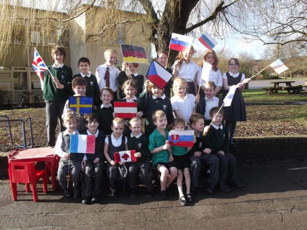 Pupils with their home-made country flags