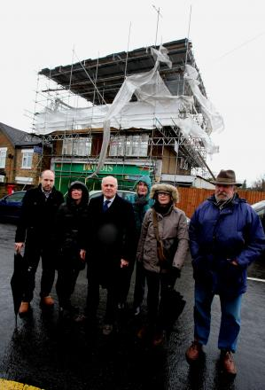 Iain Duncan Smith with residents calling for a derelict building to be brought back into use
