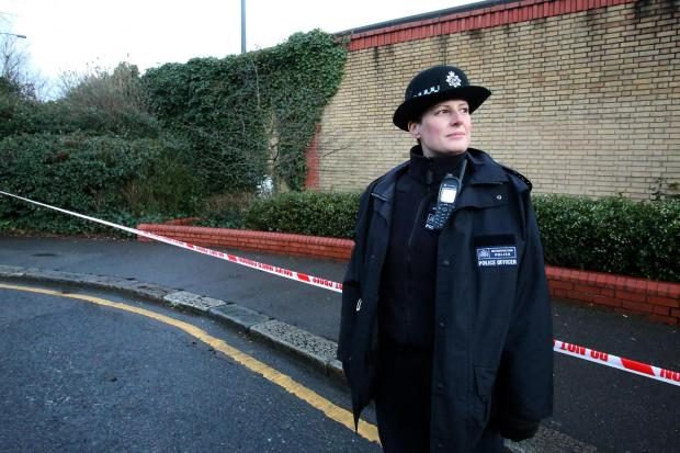 A Waltham Forest policewoman at the crime scene in Poppleton Road