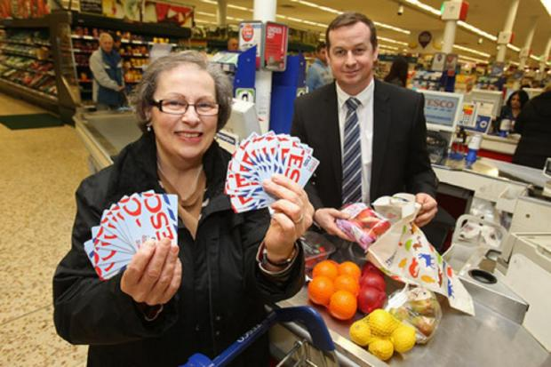 Teresa Nickolson and Edmonton Tesco Extra store manager Paul Dolling