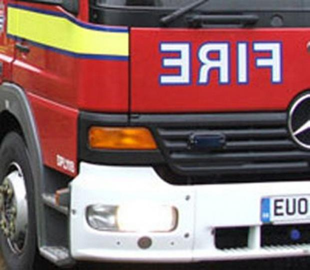 File image. Seven people evacuated after early morning fire.