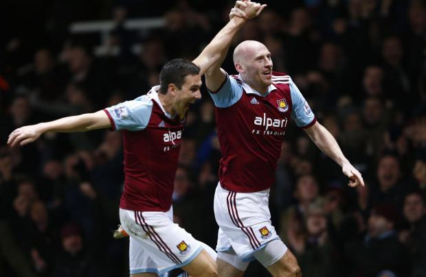 West Ham United's James Collins (R) celebrates with team mate Marco Borriello after scoring a goal against Norwich City. Picture: Action Images