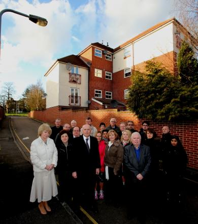 Iain Duncan Smith with residents against a planning application to double the size of a block of flats