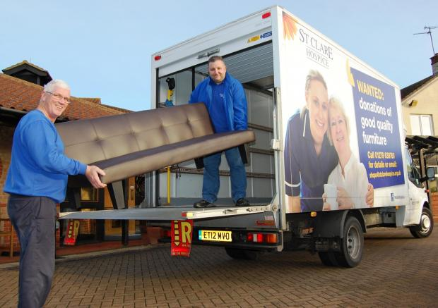 St Clare van drivers Paul and Martin with the Hospice van that was stolen but has now been recovered