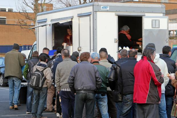 Soup kitchen users queuing for the service in Mission Grove, Walthamstow.