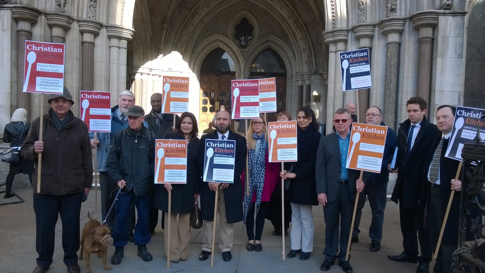 Volunteers and supporters outside the High Court yesterday