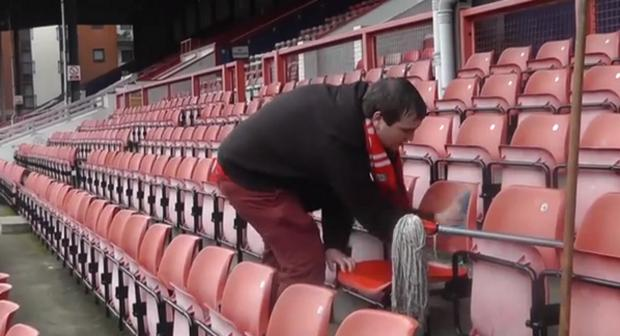 East London and West Essex Guardian Series: Craig Delew cleaning the stadium's seats