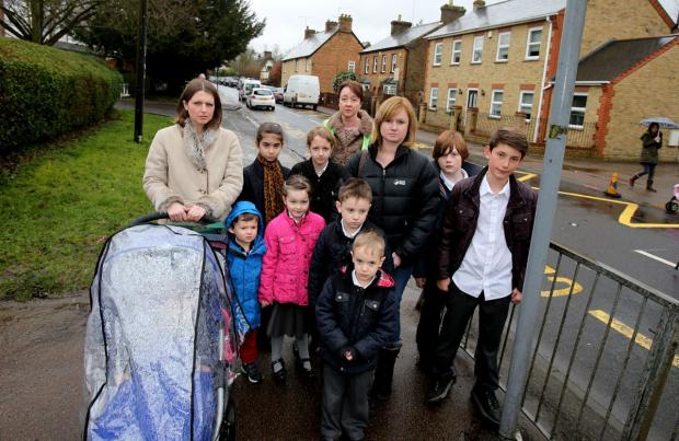 East London and West Essex Guardian Series: Headteacher Gill Doyle with parents and children outside the school