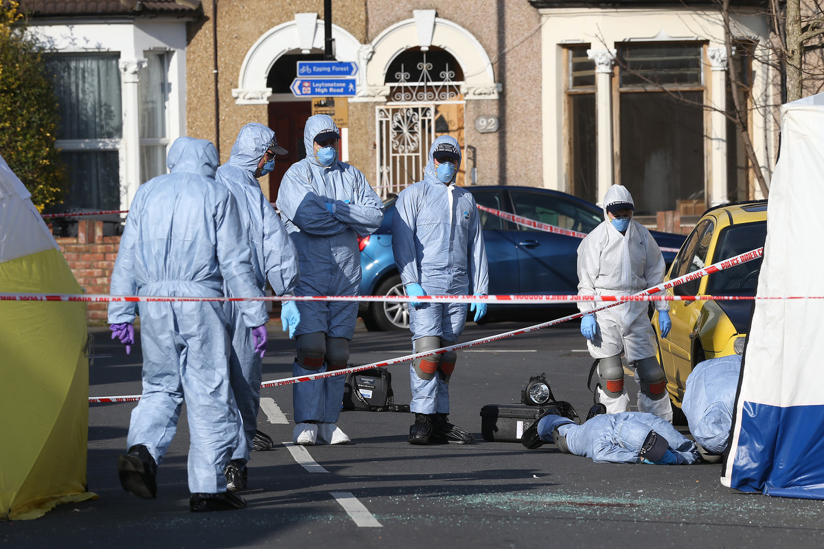 Forensic team at the crime scene of two Leytonstone men stabbed to death in March