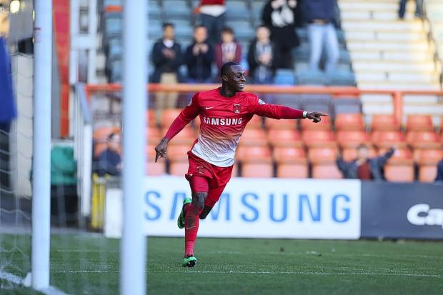 Moses Odubajo celebrates his crucial winner: Simon O'Connor
