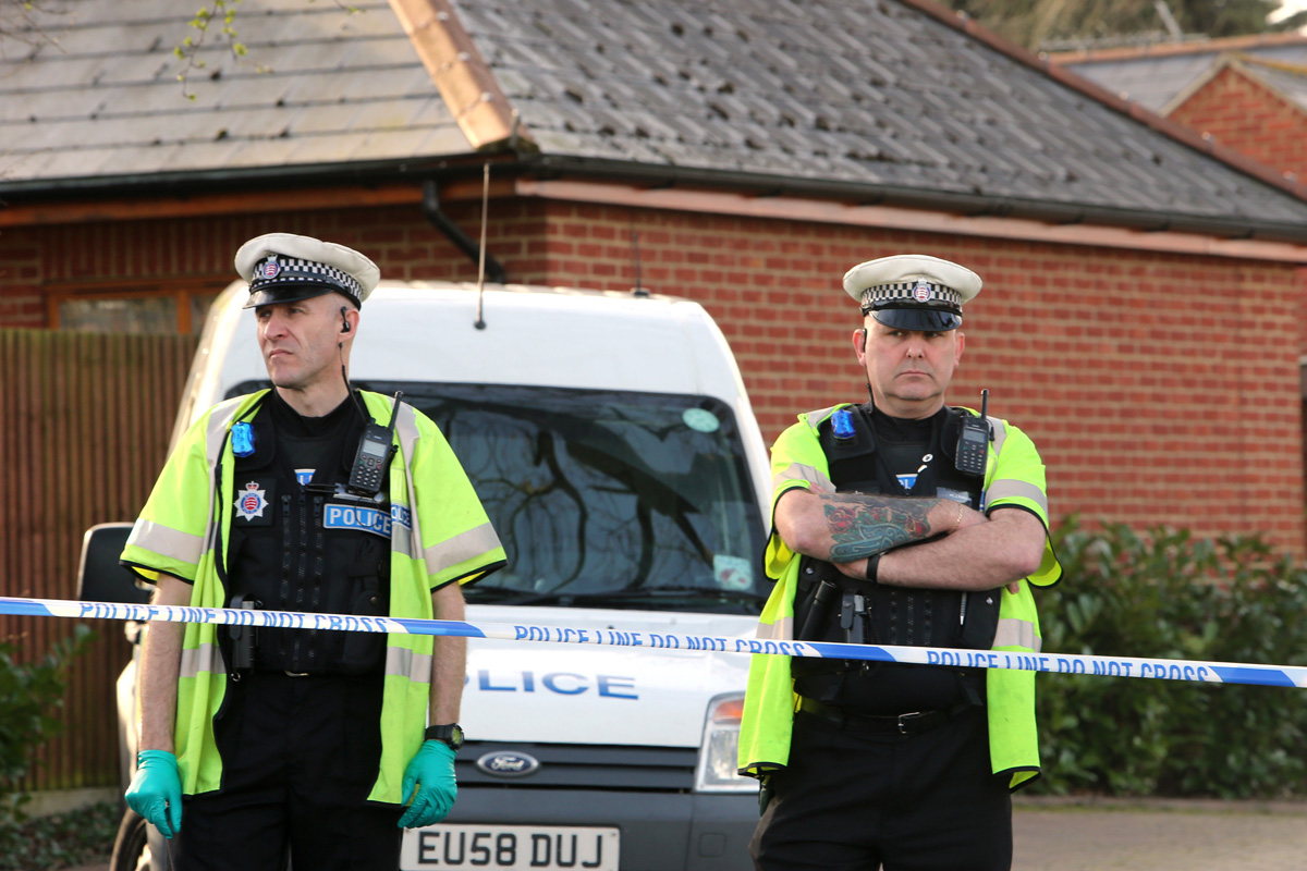 Police at the scene in Mason Way yesterday