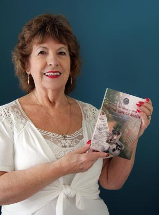Marion Cunningham with her new self-published book.