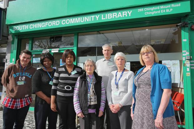 Treasurer Susan Brown (right) with volunteers outside the community library