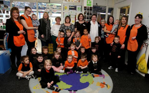 Children, staff and guests at Sunshine Nursery in Waltham Abbey.