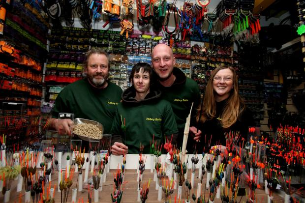East London and West Essex Guardian Series: The Abbey Bait shop in Waltham Abbey is about to be relaunched by Chris Allen, left, with staff Michael Cork, Chris Andrew and partner Sarah Springham