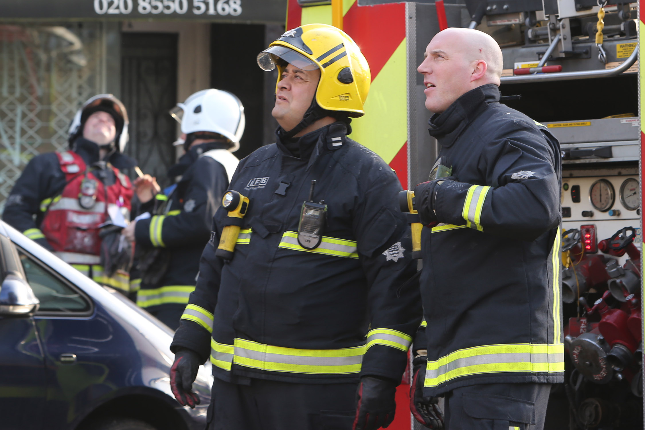Firefighters at the scene of a flat fire in Redbridge Lane East in February