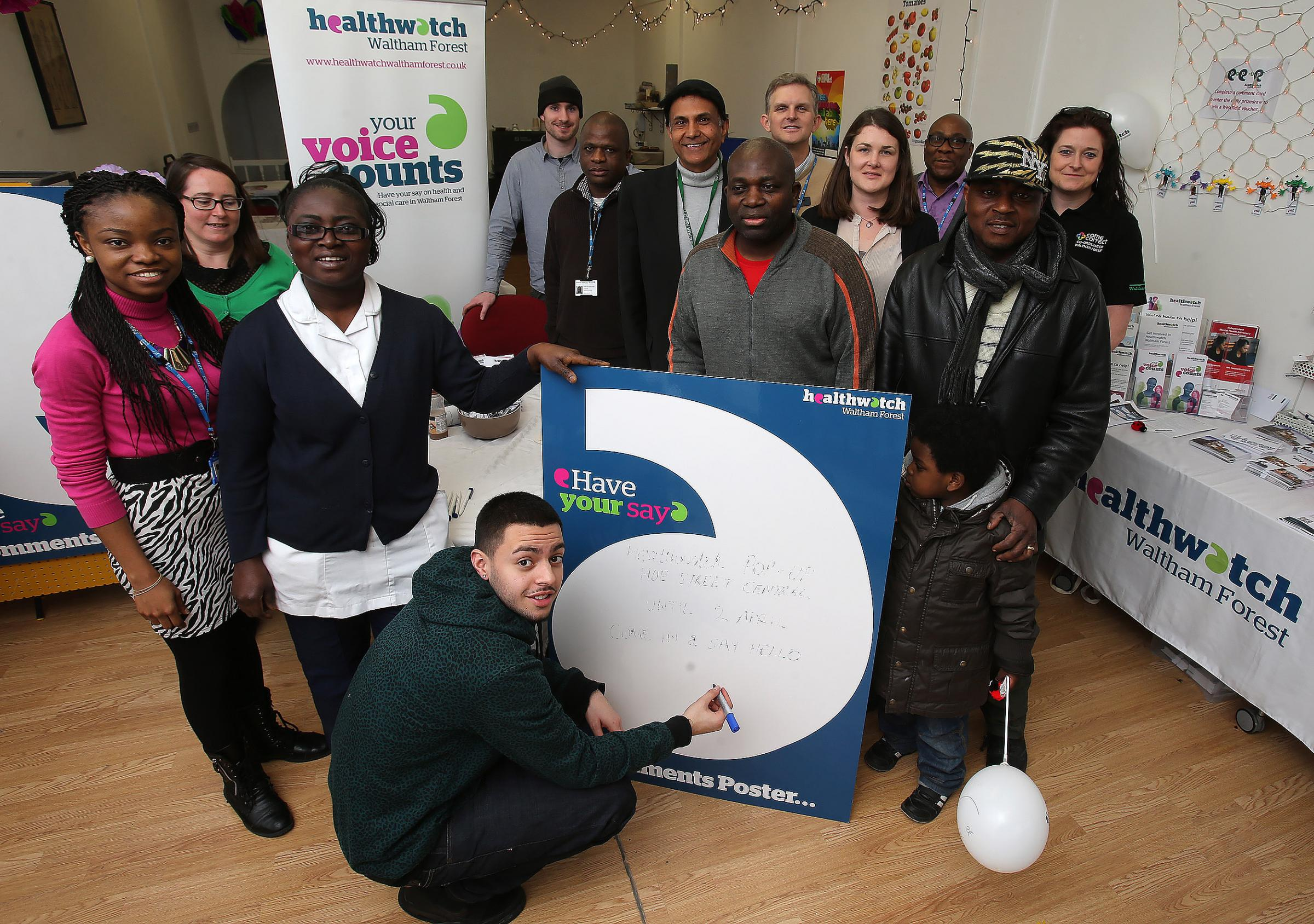Staff and visitors at a sexual health awareness event in the Walthamstow pop up shop