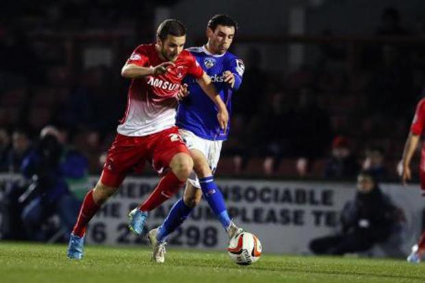 Jamie Ness in action against Oldham Athletic: (Pic: Simon O'Connor)
