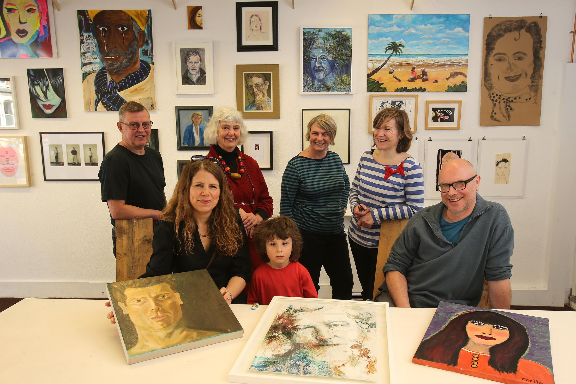 The Mill volunteers and artists with the Face Value portraits.