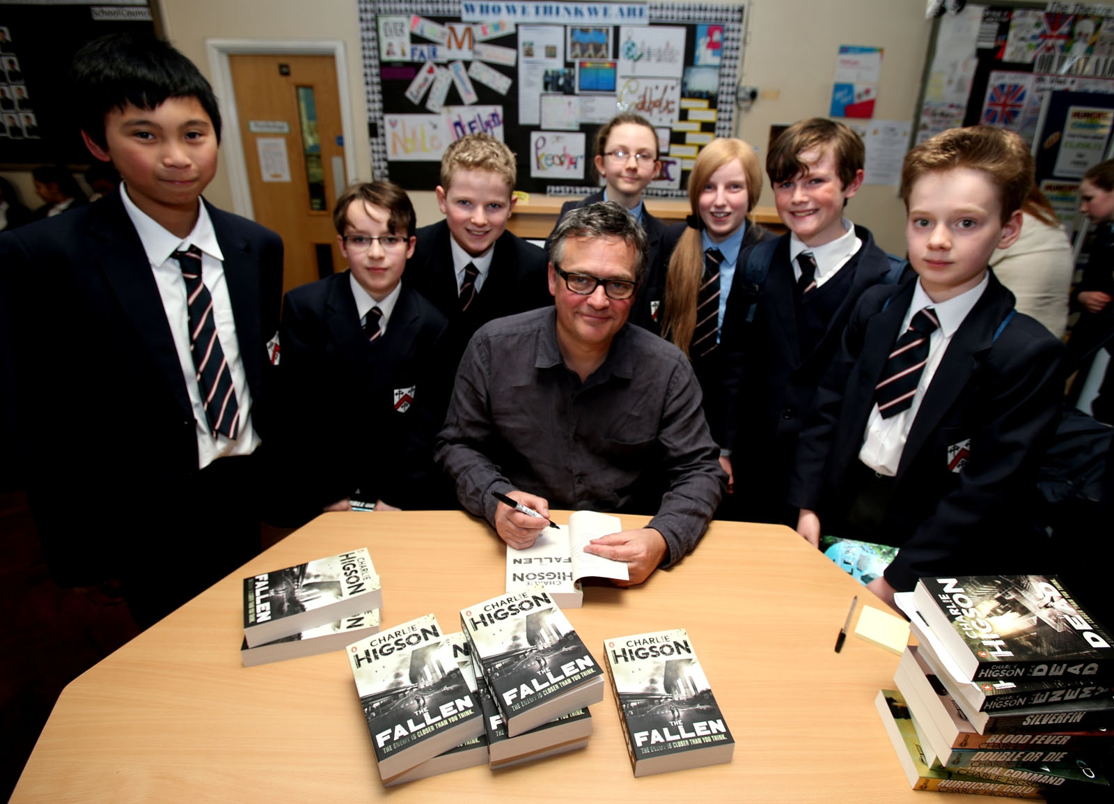 Charlie Higson met with students and signed copies of his books at Tri