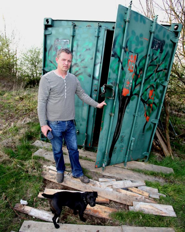 East London and West Essex Guardian Series: Mark Johnson by the container which held his tractor