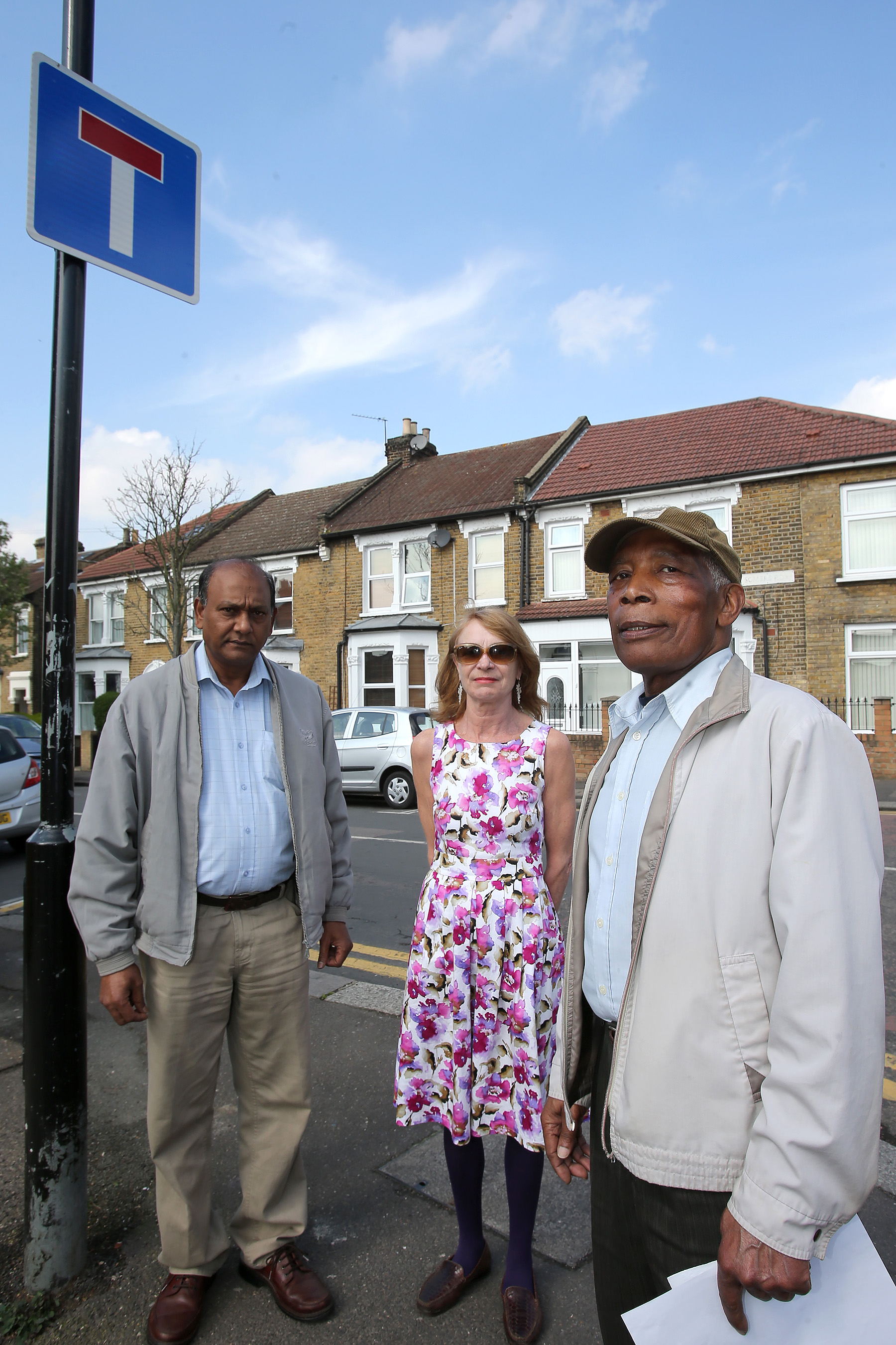 Somers Road residents Veejay Sanoo, Chrissy Ansell and Norman Blackwood are campaigning for better 'no through road' signs. This is the only sign currently indicating that the street is a dead-end.