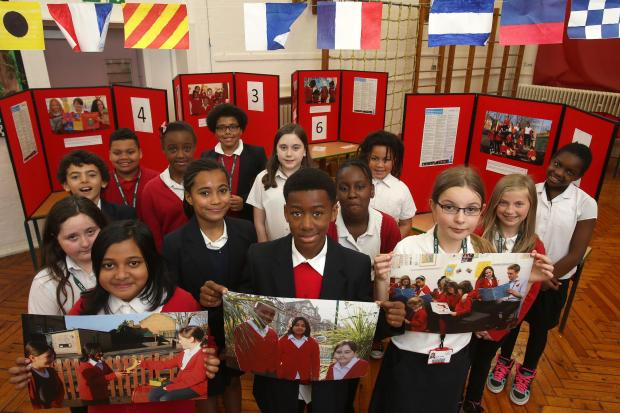 Children at The Jenny Hammond School in Leytonstone with photographs they've taken as part of a bid for a UNICEF award.