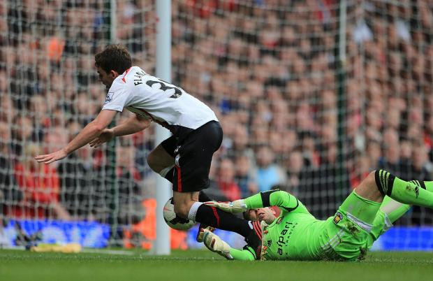Liverpool's Jon Flanagan goes down under a challenge from Adrian. Picture: Action Images