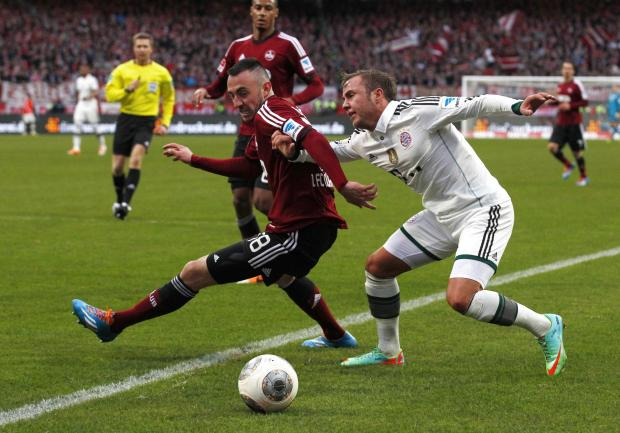 East London and West Essex Guardian Series: Josip Drmic (left), battles with Bayern's Mario Gotze (right)