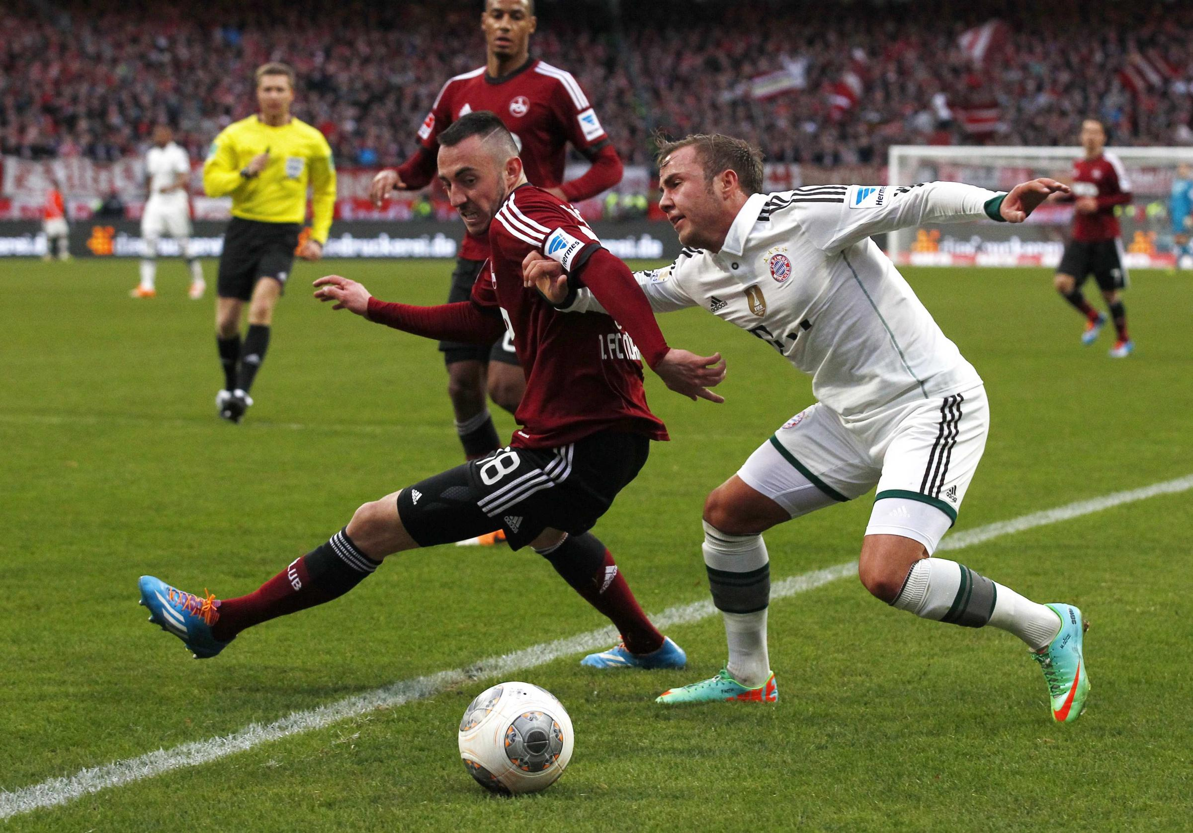 Josip Drmic (left), battles with Bayern's Mario Gotze (right)