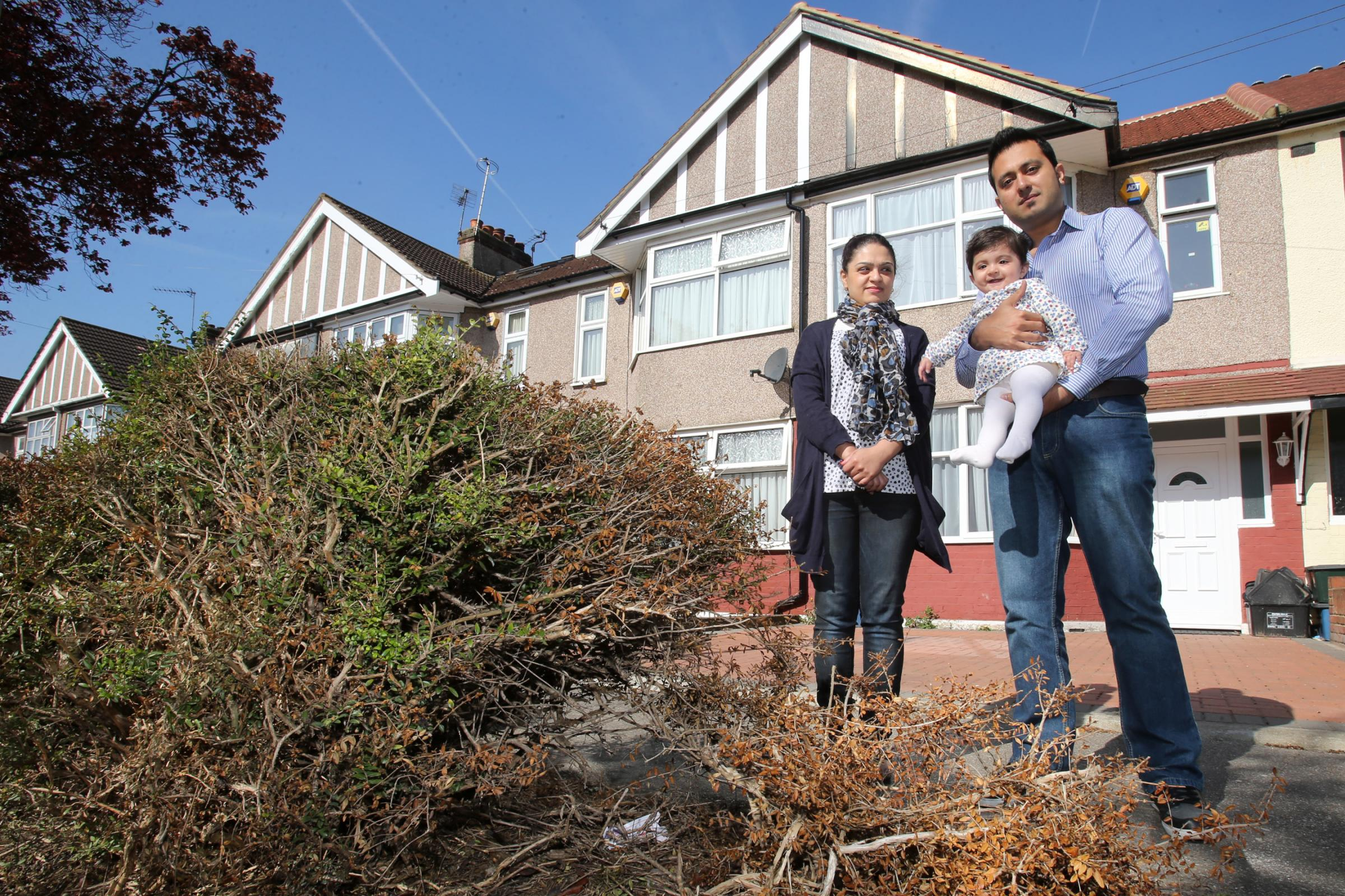 Junaid and Yasmin Muzammal with six-month-old daughter Haya outside their home.