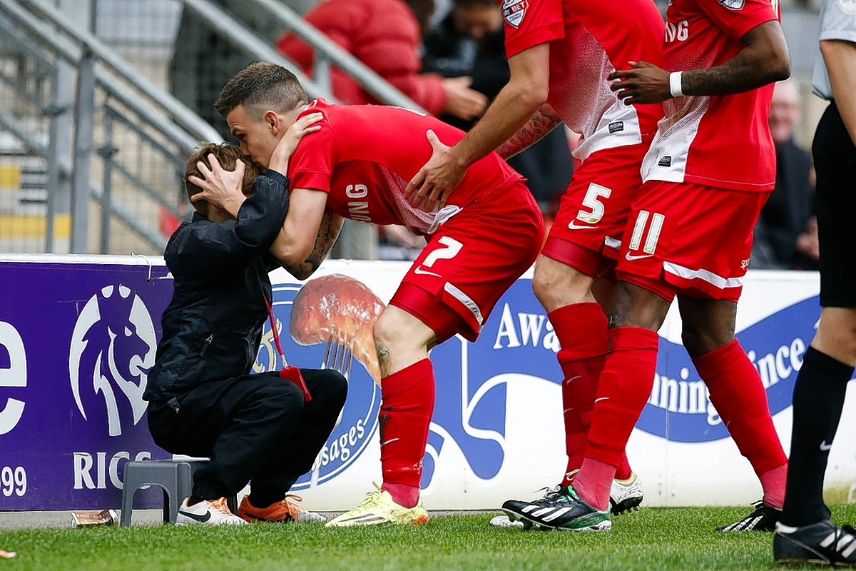 Dean Cox kisses a ball boy after scoring in their win over Gillingham: Simon O'Connor