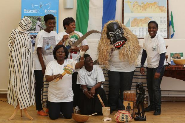Members of the Sierra Ladies celebrate Sierra Leone's independence anniversary at the Orchard Community Hall