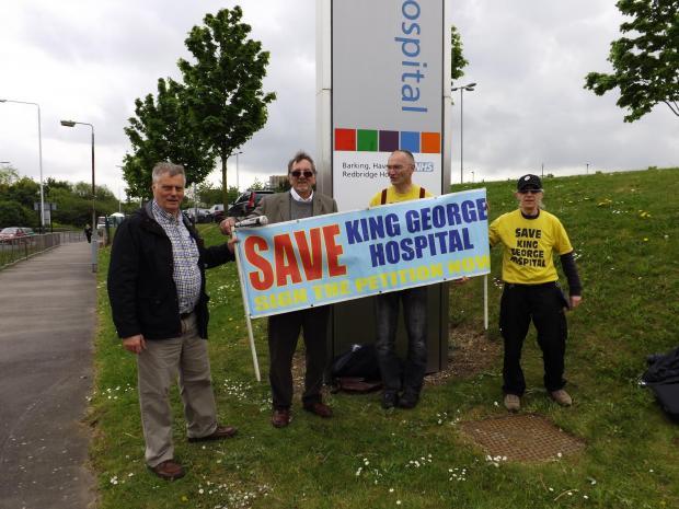 Andy Walker, second from the right, demonstrating outside King George Hospital yesterday