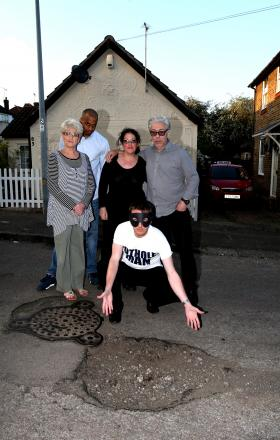 Pothole Man joined by Gladstone Road residents Wendy Ryall, Ashley Thompson and Sally-Ann and Jeff Gilbert prior to the repair