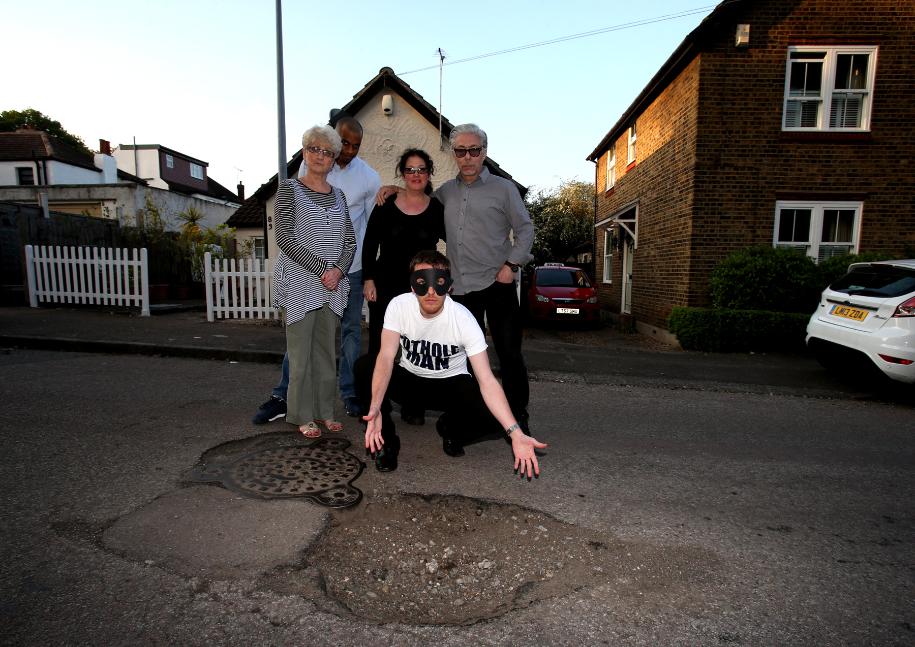 Pothole Man joined by Gladstone Road residents Wendy Ryall, Ashley Thompson and Sally-Ann and Jeff Gilbert