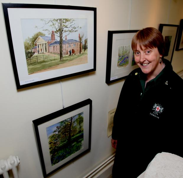 City of London Corporation information assistant Julie Cottrell with some of the art
