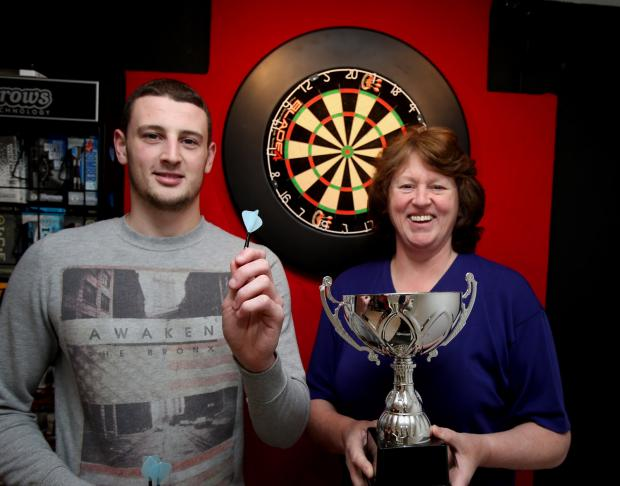 Ex world darts champion Linda Batten with son Myles at their new darts and trophy shop in Waltham Abbey